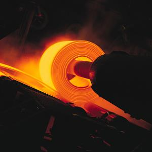 A red-hot steel sheet being rolled in a steel mill (copyright Photodisc/Getty Images)