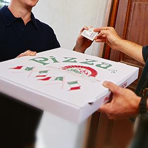 Pizza delivery (© George Doyle/Stockbyte/Getty Images)