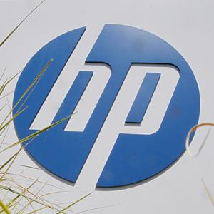 Grass in front of the Hewlett-Packard sign outside the company's headquarters in Palo Alto, Calif. (© Paul Sakuma/AP)