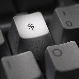 Dollar sign on keyboard copyright Corbis
