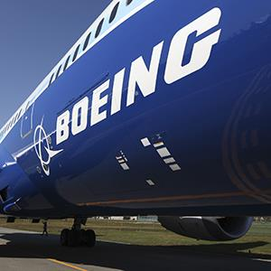 File photo of the Boeing Co. logo seen on the fuselage of a 787 Dreamliner (© SeongJoon Cho/Bloomberg via Getty Images)