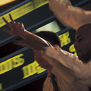 Stock market Traders (© Comstock/Corbis)