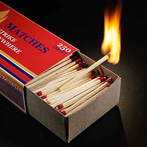 Matchbox filled with matches, one matchstick burning copyright Don Farrall/Photodisc/Getty Images