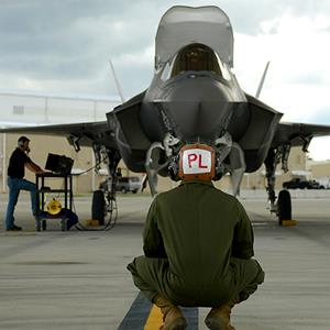 Mechanic Sgt. Stephen Fink watches a F-35B Lightning II joint strike fighter from the Marine Fighter Attack Training Squadron 501, at Eglin Air Force Base, Florida