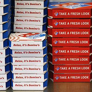 Domino's Pizza boxes (© Luke MacGregor/Newscom/Reuters)
