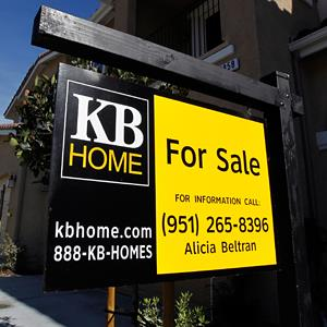 A KB Home for sale sign at a housing development in Carlsbad, Calif., on January 4, 2011 (© Mike Blake/Reuters)