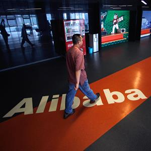 An employee walks past the Alibaba logo at its headquarters in Hangzhou, China, on June 20, 2012 (© Carlos Barria/Reuters)