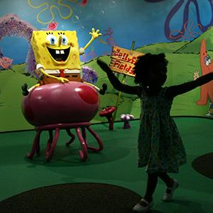 Segi Mazzarino, 3, of Manhattan, dances around the SpongeBob wax figure at Madame Tussauds Museum in Times Square, Wednesday, July 15, 2009 in New York. © Mary Altaffer/AP