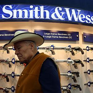 An attendee walks through the Smith and Wesson booth during the 2013 NRA Annual Meeting and Exhibits at the George R. Brown Convention Center on May 3, 2013 in Houston, Texas. © Justin Sullivan/Getty Images