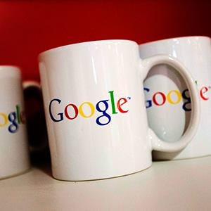 Coffee cups with Google logos are seen at the Google office in Toronto on November 13, 2012 (© Mark Blinch/Newscom/Reuters)