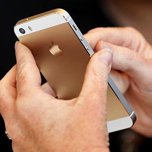 The gold colored version of the new iPhone 5S is seen after Apple Inc's media event in Cupertino, California September 10, 2013.