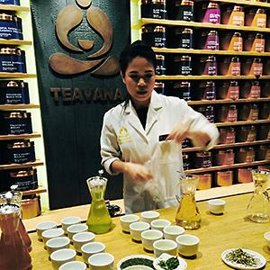 A Starbucks employee shows the new Teavana 'tea bar' in New York. © Candice Choi/AP