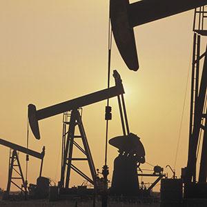 Image: Oil derricks (© Comstock/Corbis)