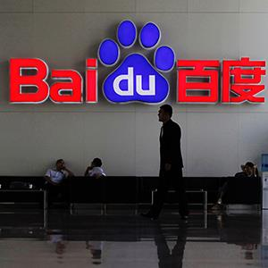 File photo of security guard walking past the company logo of Baidu at its headquarters in Beijing. © Soo Hoo Zheyang/Reuters