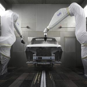 Robotic arms spray a Range Rover Sport automobile