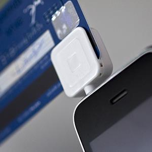 File photo of Square, a credit card reader made for smartphones, plugged into an Apple Inc. iPhone (© Jin Lee/Bloomberg via Getty Images)