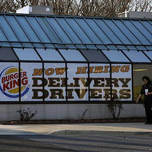 File photo of a sign on a Burger King in Olney, Maryland advertising delivery jobs on March 7, 2012 (© Michael S.Williamson/The Washington Post via Getty Images)