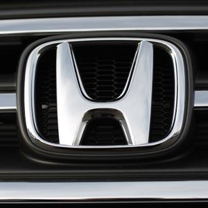 Honda logo on the grille of an 2013 Pilot at the Honda dealership in Littleton, Colo. (© David Zalubowski/AP Photo)