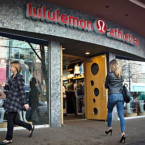 Caption: A customer enters the Lululemon store in downtown Vancouver, British Columbia November 8, 2013