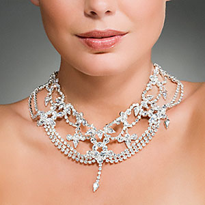 Image: Woman wearing a diamond necklace © Image Source, Corbis