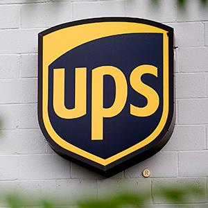 The UPS logo is seen on the side of a customer center building in Alexandria, Va. © Andrew Harrer/Bloomberg via Getty Images