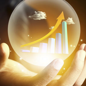 Hand holding stock chart in crystal ball © shutter_m/Getty Images