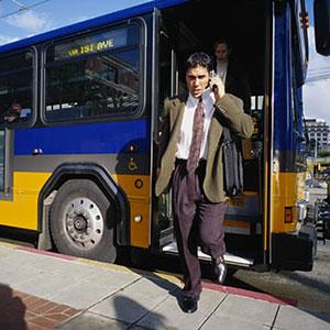 Businessman and bus ( Photodisc Green/Getty Images)