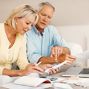 Image: Mature couple calculating expenses  Abel Mitja Varela, the Agency Collection, Getty Images