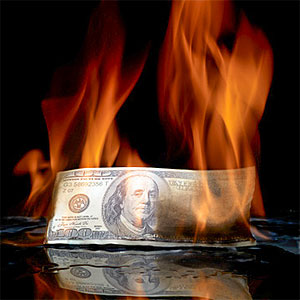 Burning money &#169; Lumina Imaging, Digital Vision, Getty Images