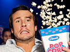 Image: Man reacting to a film at the cinema, popcorn flying (© i love images/Cultura RF/Getty Images)