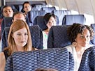 Image: Passengers on an airplane (© Image Source/Getty Images)