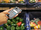 Image: Close-up of a person using a calculator in a supermarket (© George Doyle/Stockbyte/Getty Images)