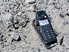 Image: Damaged cell phone ( Nick Koudis/Getty Images)