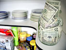 Image: U. S. banknotes on shelf in kitchen pantry (© Supapixx /Alamy)