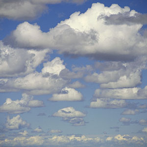 Logo: Clouds in a blue sky (Purestock/Getty Images)