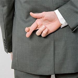 Image: Dishonest man (Halfdark/fStop/Getty Images)