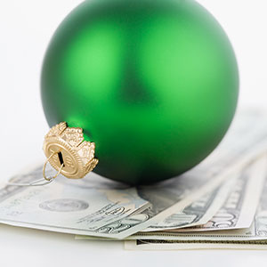 Image: Ornament and money © Tetra Images, Corbis