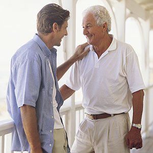 Logo: Adult with elderly parent (Digital Vision/SuperStock)