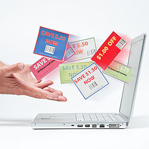 Image: Hands catching shopping coupons  Vstock LLC/Tetra images RF/Getty Images