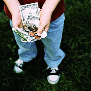 Logo: Boy holding allowance money (Bryan Mullennix/Photodisc/Getty Images)