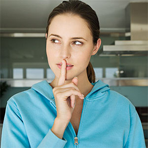 Logo: Portrait of a young woman, finger on lips (Pascal Broze, ONOKY, Getty Images)
