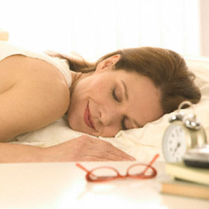 Logo: Woman asleep (Tom Grill/Corbis)