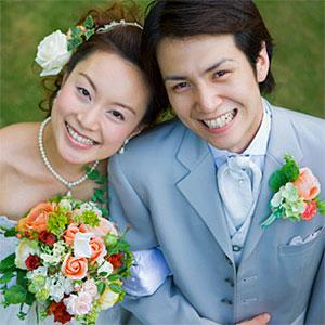 Bride and groom arm in arm, smiling, high angle view, portrait -- BLOOM image, BLOOMimage, Getty Images