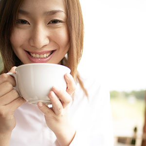 Image: Coffee Woman (Bloomimage/Corbis)