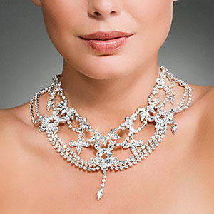 Image: Woman wearing a diamond necklace - Image Source, Corbis