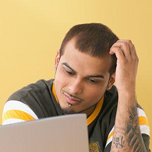 Image: Man with computer (Jose Luis Pelaez, Inc./Blend Images/Corbis)