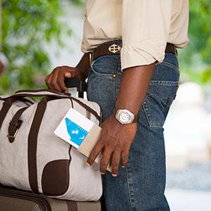 Image: Passport and Luggage (GoGo Images/Jupiterimages)
