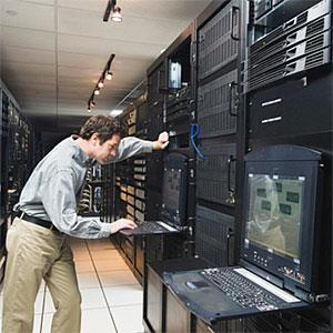 Man working in data center -- Erik Isakson, Tetra images, Getty Images