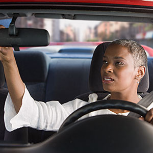 Image: Woman in car adjusting mirror -- Jose Luis Pelaez Inc, Blend Images, Getty Images