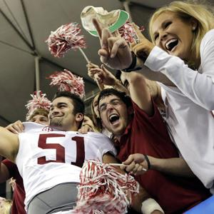 Alabama long snapper Carson Tinker poses for photos with fans on Dec. 1, 2012 (Dave Martin/AP Photo)